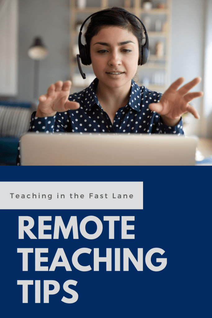 Image of teacher with headset on gesturing at an open laptop.